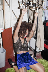 Young woman dancing backstage