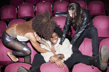 Young people hanging out backstage at a theater