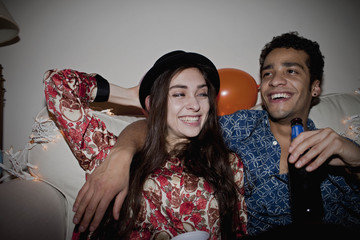 Smiling couple enjoying during party