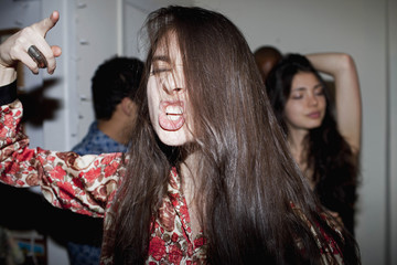 Young woman dancing at a party
