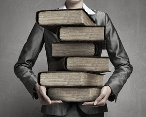 Woman carrying stack of books . Mixed media
