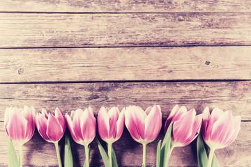 Vintage Tulip Flowers on Wooden Backdrop