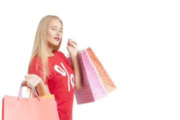 Portrait Of Young Woman Wearing perecentage symbol T-shirt Holding Shopping Bag on a white background