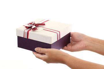 Hands holding a gift box against white background