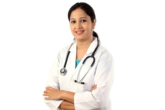 Happy young female doctor against white background