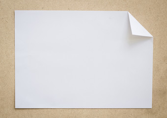 Full page of White paper folded on wood brown background