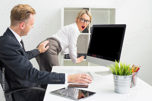 Business man touching secretaries butt