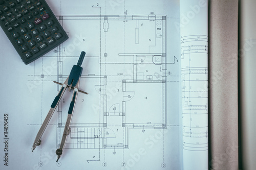Blueprints with calculator and compass divider stock for Blueprint estimator