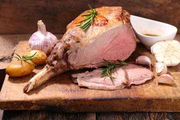 roasted lamb leg on wooden board