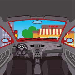 Car interior with street and shop view