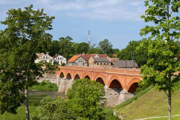 Wide bridge above river.