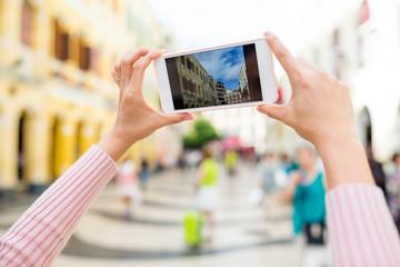 Woman taking photo of Senado Square