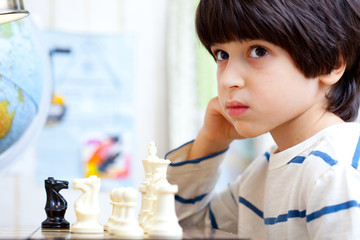 boy playing a game of chess