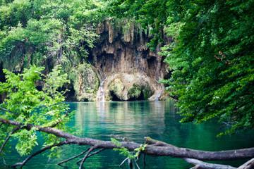 Wall Mural - Steep bank of lake looks like dogs face. Croatian national park Plitvice Lakes