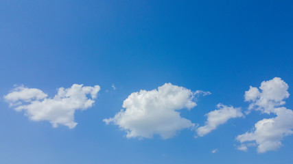 White clouds with blue sky background.