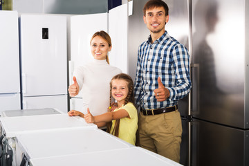 Family choosing refrigerator in store
