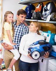 Family selecting vacuum cleaner