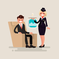 Business Class. The stewardess brings businessman the glass of c