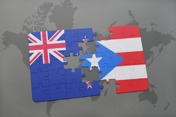 puzzle with the national flag of new zealand and puerto rico on a world map background. 3D illustration