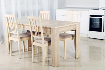 Wooden table and chairs in the kitchen