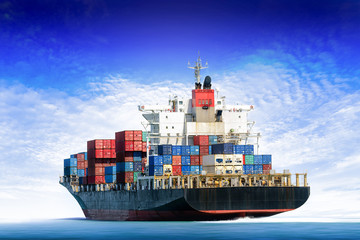 Cargo ship in the ocean with  blue sky, Freight Transportation.