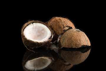 Coconuts shells on black background