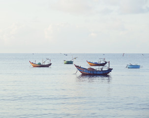 vietnameese national boats in sea at sunrise