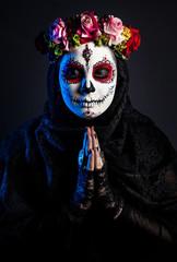 Sugar skull girl with flowers