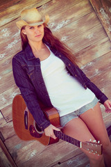 Country Girl Holding Guitar