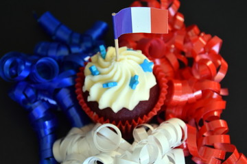 Happy Bastille Day cupcake with red, white and blue french flag. Vive La France.