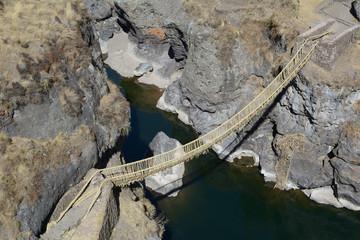Ancient rustic bulrush sedge suspension bridge