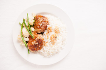 tasty chicken thighs with rice and vegetables