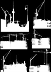 set of six buildings and cranes isolated on black