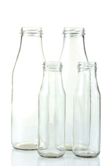 empty glass bottles for milk isolated on white background