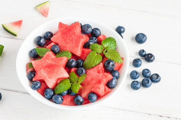 Summer fruit salad of watermelon and blueberries, top view