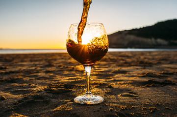 glass of soda on the beach.