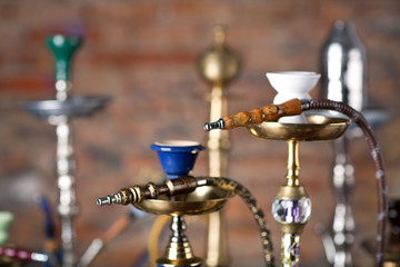 group of eastern hookahs on table