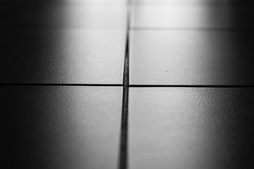 Tiles on the floor with backlight. Black and white photo