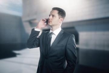 Attractive businessman on phone