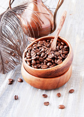roasted coffee beans in wooden bowl, selective focus