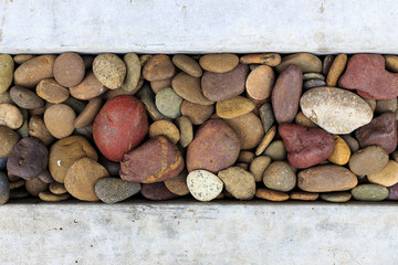 abstract background with decorative floor pattern of gravel stones, over light