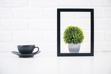 Coffee and plant inside frame