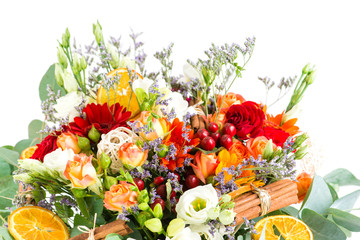 a bouquet of flowers with orange slices and cinnamon, floral bac