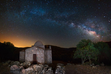 Ancient countryside church under the milky way