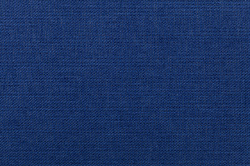 Dark blue background from textile material. Fabric with natural texture.