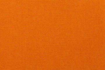 Bright orange background from textile material. Fabric with natural texture.