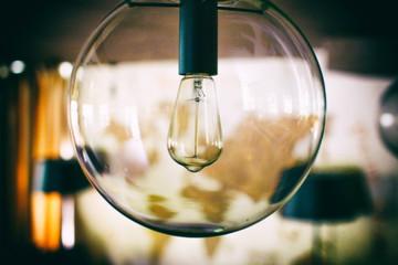 decorative lamp stylized under olden time. edison style filament light bulbs. closeup.