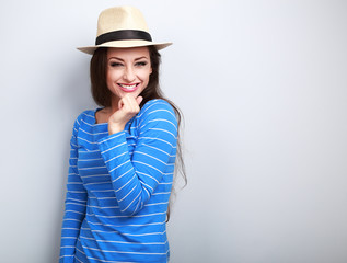 Beautiful long hair laughing woman in blue top and straw hat loo