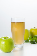 Fresh apples and glass of apple juice.