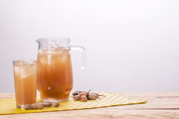 Pitcher and glass of tamarind drink.